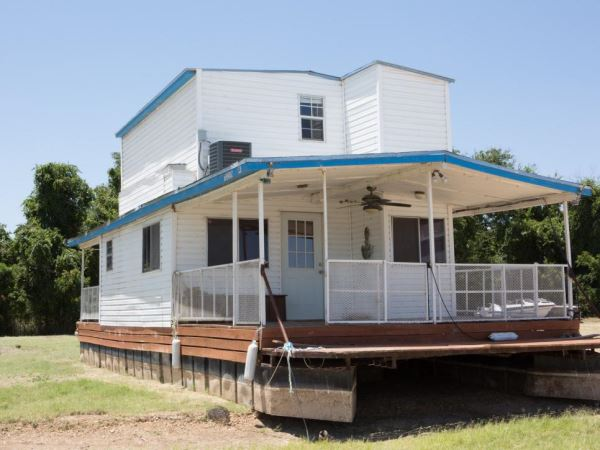Land Locked To Lake Fixer Upper Takes On 1970 S Houseboat
